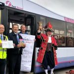 local dignatories welcome the community bus