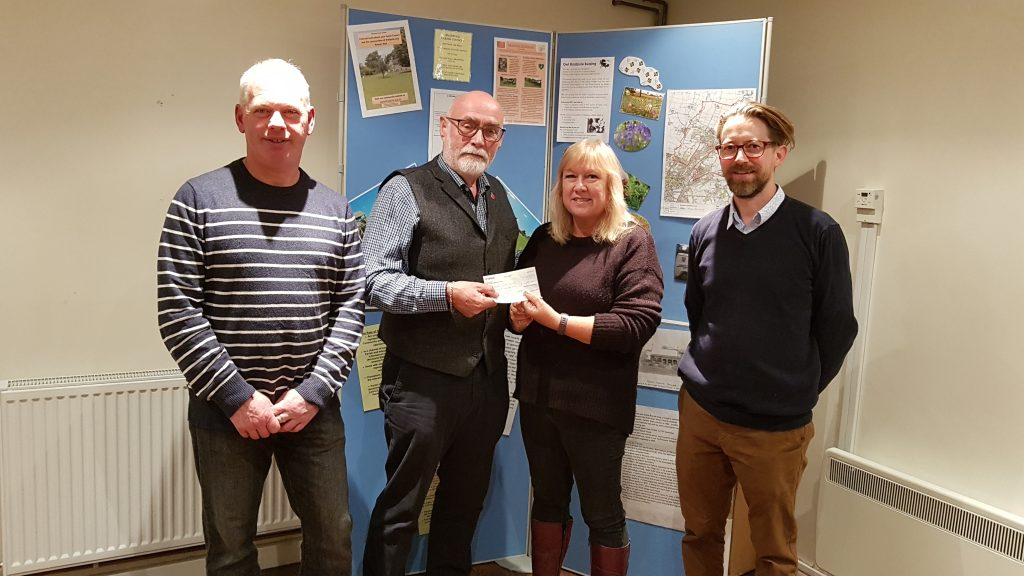 "alt+""Committee members hand a cheque over to the Chairman of Bradpole council"""