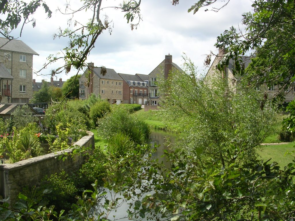 "alt=""The River Brit passes through the old industrial settlement of Pymore"""